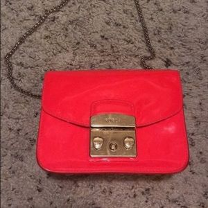 Furla metropolis mini leather bag. Patent Pink.